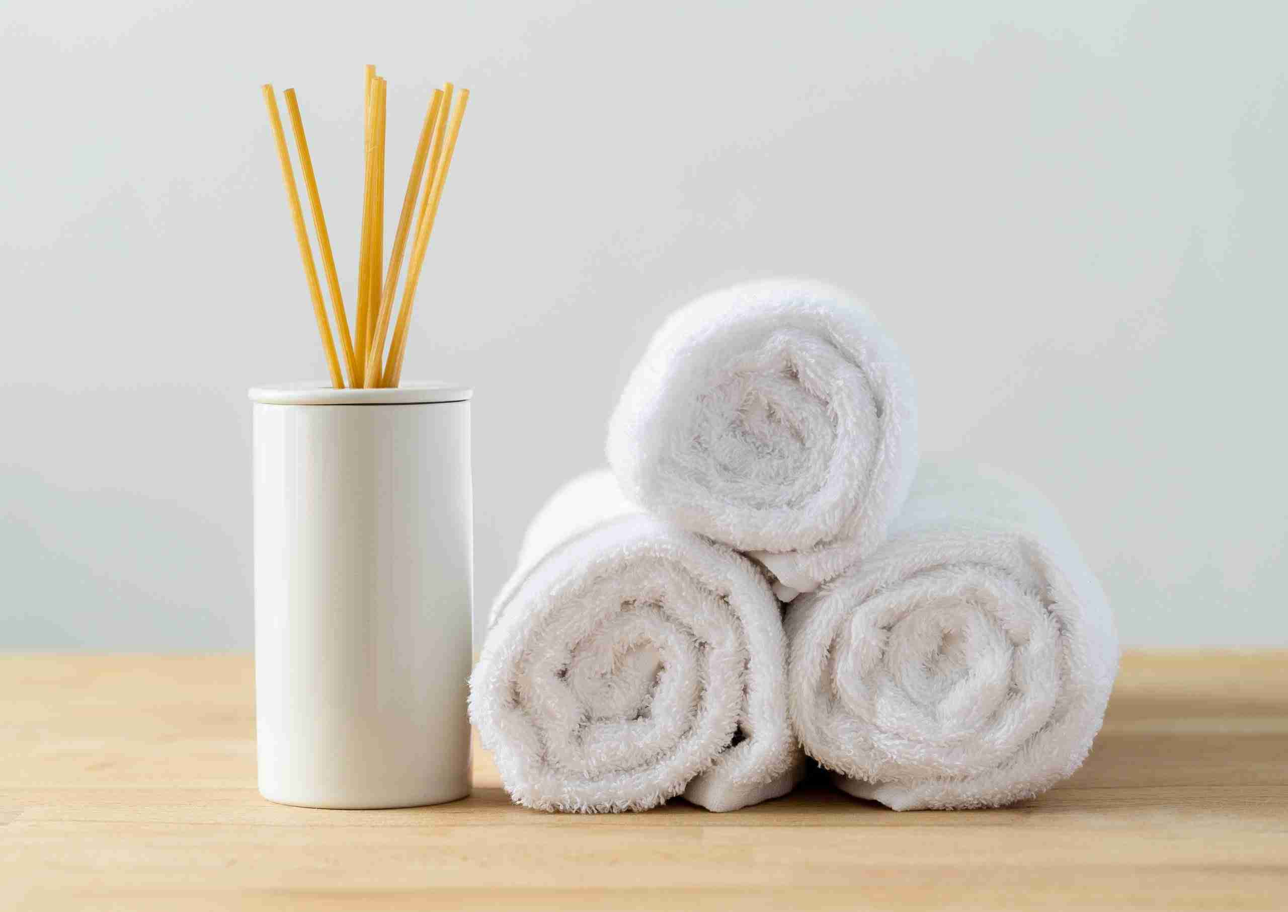 White towels and scented woods