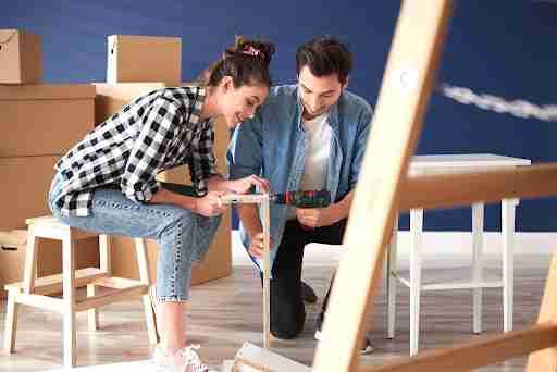 Couple installing furniture