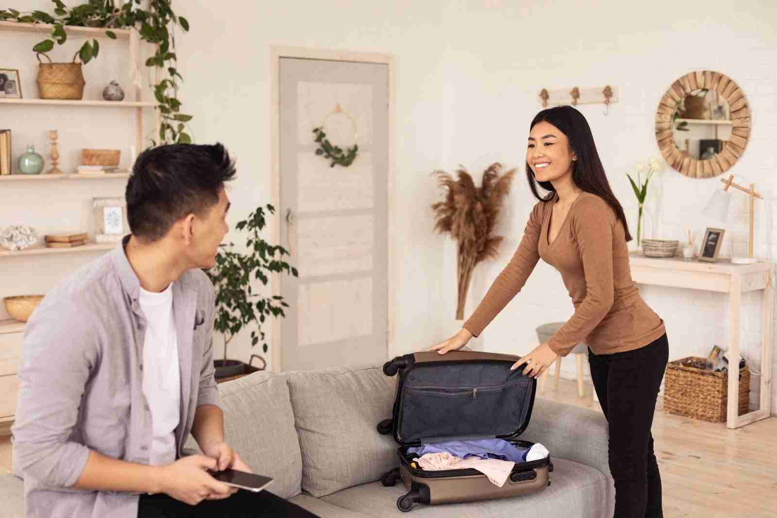 Couple unpacking in Airbnb