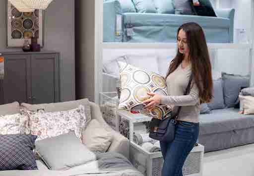 Woman buying furniture at a store